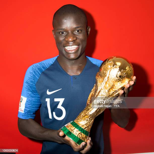 Golo Kante of France poses with the Champions World Cup trophy after the 2018 FIFA World Cup Russia Final between France and Croatia at Luzhniki...
