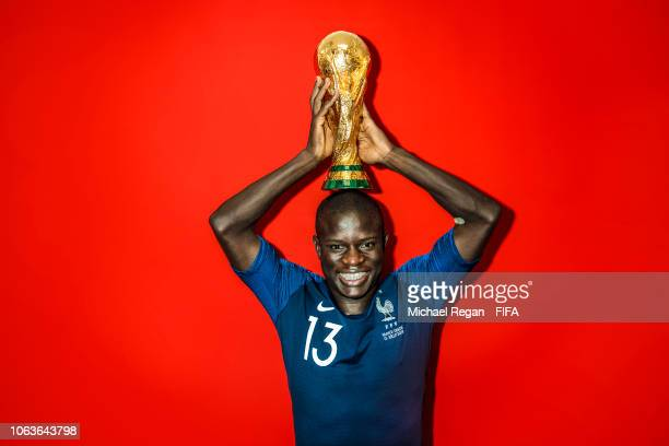 N'Golo Kante of France poses with the Champions World Cup trophy after the 2018 FIFA World Cup Russia Final between France and Croatia at Luzhniki...