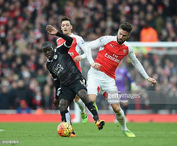 N'golo Kante of Leicester City and Olivier Giroud of Arsenal in action during the Barclays Premier League match between Arsenal and Leicester City at...