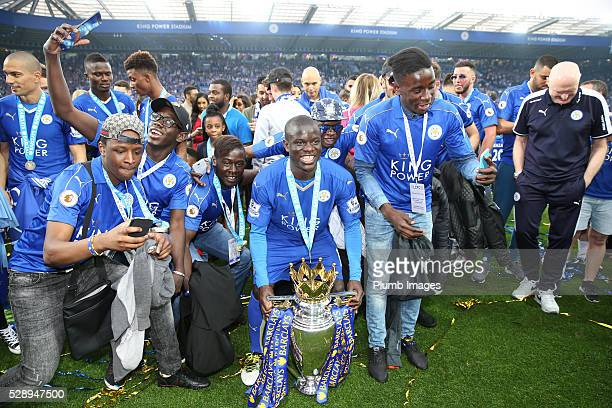 Golo Kante of Leicester City celebrates with the Premier League trophy at the King Power Stadium on May 7th 2016 in Leicester United Kingdom