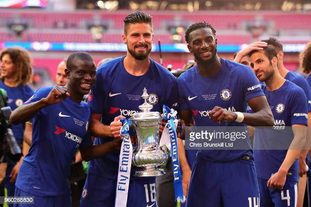 Golo Kante Olivier Giroud and Tiemoue Bakayoko all of Chelsea celebrate with the FA Cup trophy after the Emirates FA Cup Final between Chelsea and...