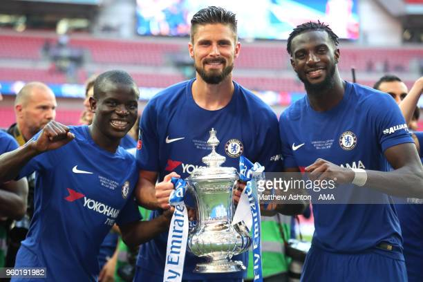 Golo Kante Olivier Giroud and Tiemoue Bakayoko of Chelsea pose with the trophy at the end of the Emirates FA Cup Final between Chelsea and Manchester...