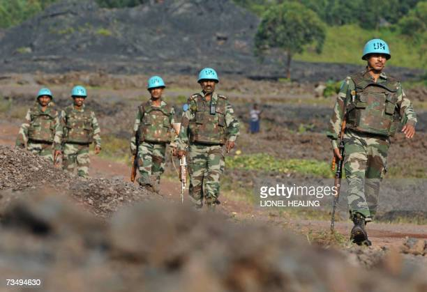A UN patrol of Indian peacekeepers walks along a road 05 March 2007 in Goma An estimated three million people in the sprawling nation almost the size...