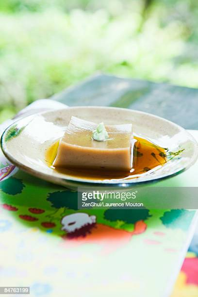 goma dofu (tofu made from ground sesame paste and kudzu powder), served with soy sauce and wasabi - wasabi paste stock pictures, royalty-free photos & images