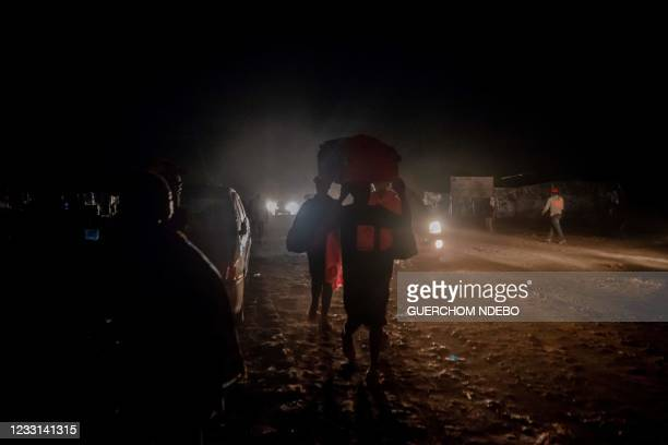 Goma residents arrive in Sake, 25km Nort-West of Goma, where they fled after the local authorities ordered the population to evacuate the city on May...