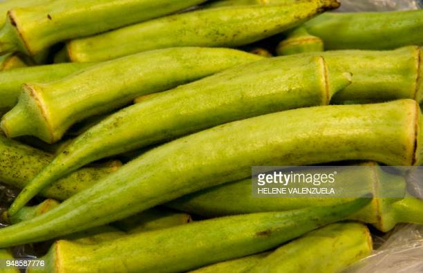 Gombo or okra is pictured at the fruit and vegetable department of an 'O Marche' supermarket in SaintFrancois on the French overseas territory of...