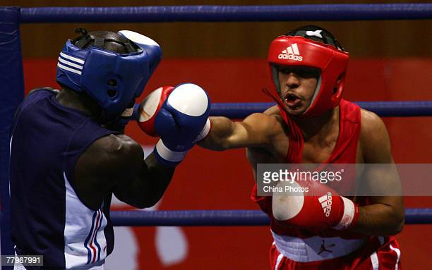 """Gomis Jean of France fights against Ali Sadam of the USA during the Men's Light Weight Preliminaries at the """"Good Luck Beijing"""" International Boxing..."""