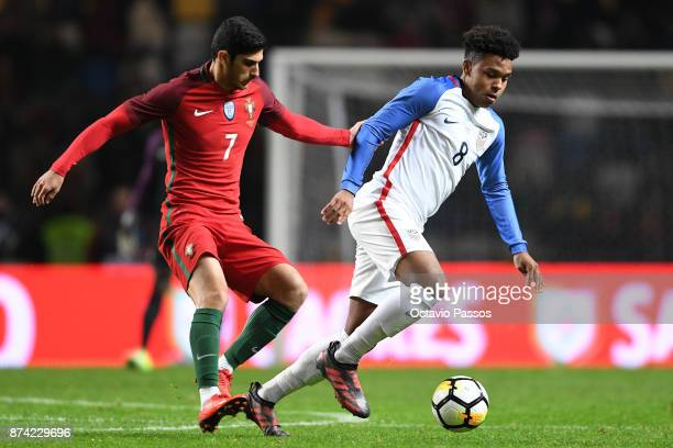 Gonçalo Guedes of Portugal competes for the ball with Weston McKennie of USA during the International Friendly match between Portugal and USA at...
