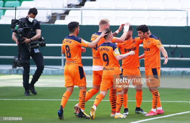 Gonçalo Guedes of Valencia CF celebrates scoring a goal with team mates during the La Liga Santander match between Real Betis and Valencia CF at...