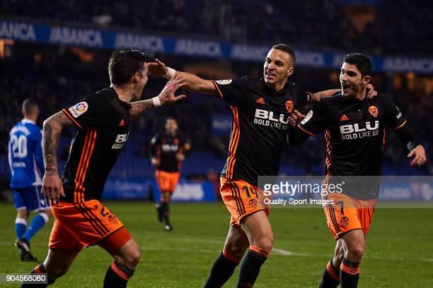 Gonçalo Guedes Rodrigo Moreno and Santi Mina of Valencia CF celebrate the opening goal during the La Liga match between Deportivo La Coruna and...