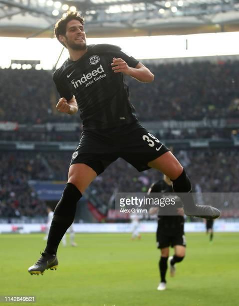 Gonçalo Paciência of Frankfurt celebrates scoring the first goal during the Bundesliga match between Eintracht Frankfurt and FC Augsburg at...