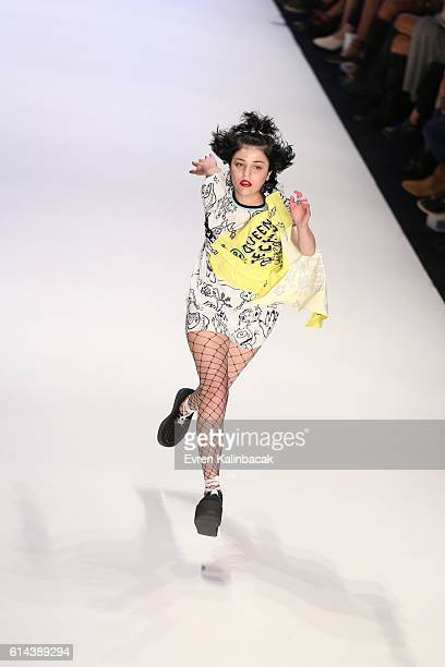 Gonca Vuslateri walks the runway at the DB Berdan show during MercedesBenz Fashion Week Istanbul at Zorlu Center on October 13 2016 in Istanbul Turkey