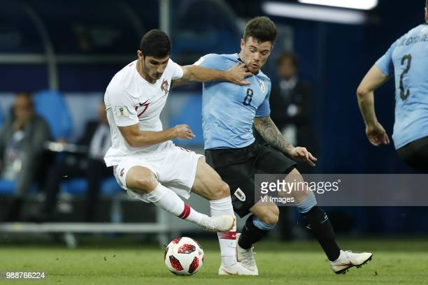 Goncali Guedes of Portugal Nahitan Nandez of Uruguay during the 2018 FIFA World Cup Russia round of 16 match between Uruguay and at the Fisht Stadium...
