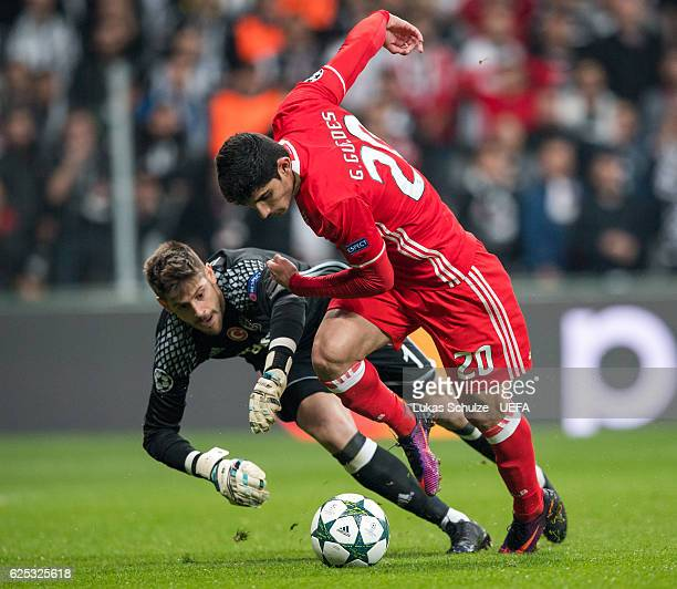 Goncalo Guedes of Benfica scores against Goalkeeper Fabricio of Istanbul during the UEFA Champions League match between Besiktas JK and SL Benfica at...