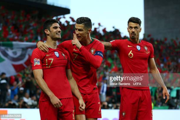 Goncalo Guedes of Portugal celebrates with teammate Cristiano Ronaldo after scoring his team's first goal during the UEFA Nations League Final...