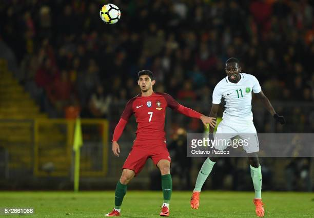 Goncalo Guedes of Portugal competes for the ball with Abdulmalek Alkhaibri of Saudi Arabia during the International Friendly match between Portugal...