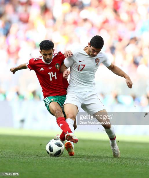 Goncalo Guedes of Portugal is challenged by Mbark Boussoufa of Morocco during the 2018 FIFA World Cup Russia group B match between Portugal and...