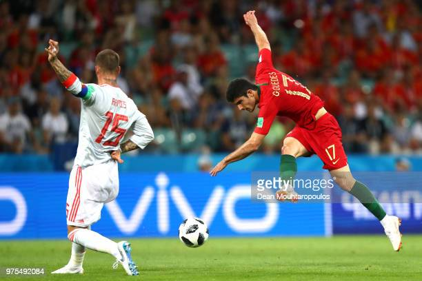 Goncalo Guedes of Portugal shoots under pressure of Sergio Ramos of Spain during the 2018 FIFA World Cup Russia group B match between Portugal and...
