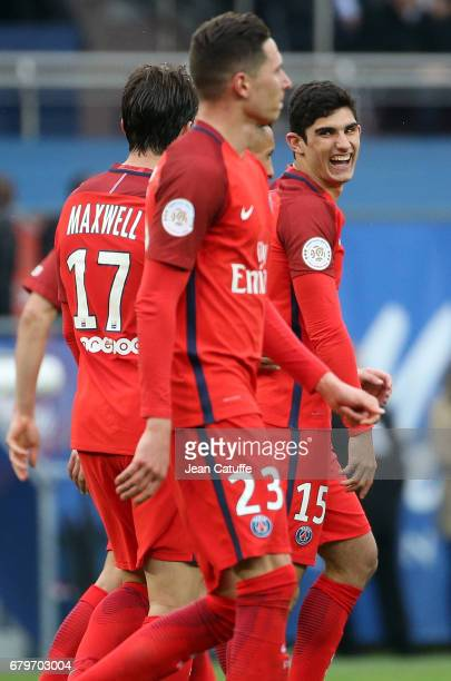 Goncalo Guedes of PSG is celebrated for his first assist for Edinson Cavani's goal during the French Ligue 1 match between Paris SaintGermain and SC...