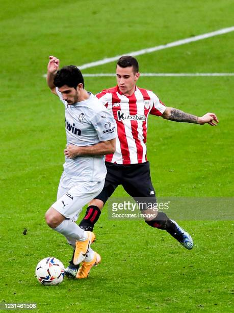 Goncalo Guedes of Valencia, Alex Berenguer of Athletic Bilbao during the La Liga Santander match between Athletic de Bilbao v Valencia at the Estadio...