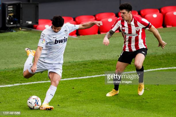 Goncalo Guedes of Valencia, Ander Capa of Athletic Bilbao during the La Liga Santander match between Athletic de Bilbao v Valencia at the Estadio San...