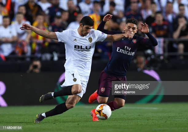Goncalo Guedes of Valencia battles for possession with Lucas Torreira of Arsenal during the UEFA Europa League Semi Final Second Leg match between...