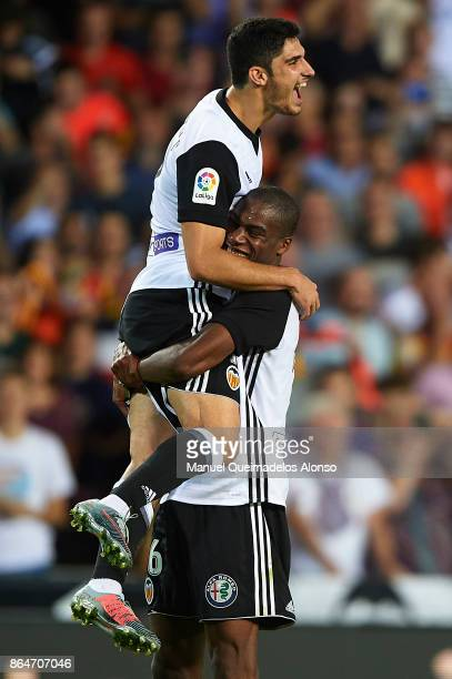 Goncalo Guedes of Valencia celebrates scoring his team's fouth goal with his teammate Geoffrey Kondogbia during the La Liga match between Valencia...