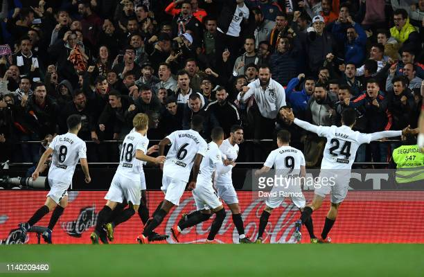 Goncalo Guedes of Valencia celebrates with his team mates after scoring his side's first goal during the La Liga match between Valencia CF and Real...