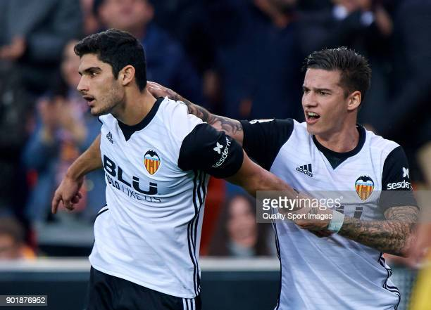 Goncalo Guedes of Valencia celebrates with Santi Mina of Valencia the second goal during the La Liga match between Valencia and Girona at Mestalla...