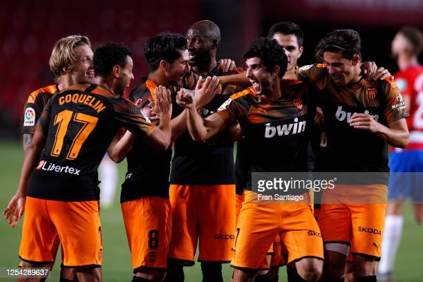 Goncalo Guedes of Valencia CF celebrates scoring his teams second goal of the game with team mates during the Liga match between Granada CF and...