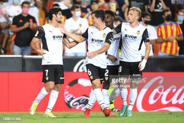 Goncalo Guedes of Valencia CF celebrates with Hugo Guillamon and team mates after scoring their side's third goal during the La Liga Santander match...