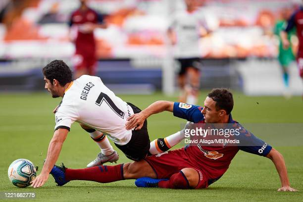 Goncalo Guedes of Valencia CF competes for the ball with Unai Garcia of CA Osasuna during the Liga match between Valencia CF and CA Osasuna at...