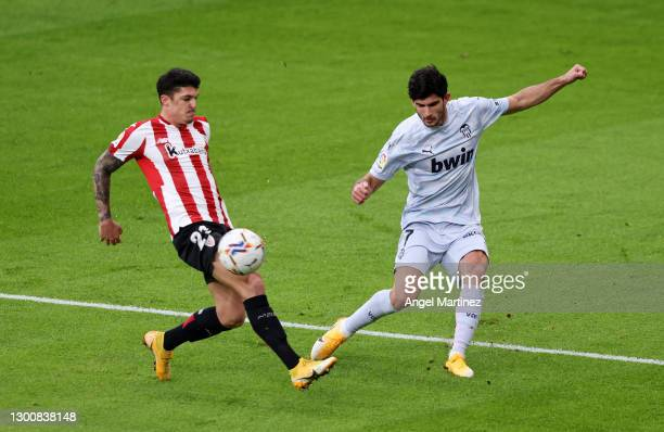 Goncalo Guedes of Valencia CF is challenged by Ander Capa of Athletic Bilbao during the La Liga Santander match between Athletic Club and Valencia CF...