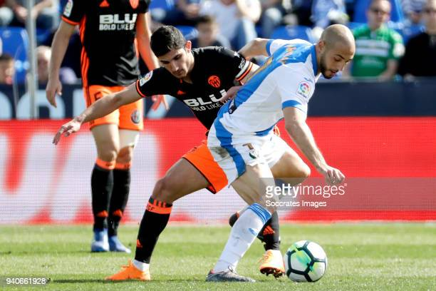 Goncalo Guedes of Valencia CF Nordin Amrabat of Leganes during the La Liga Santander match between Atletico Madrid v Deportivo la Coruna at the...