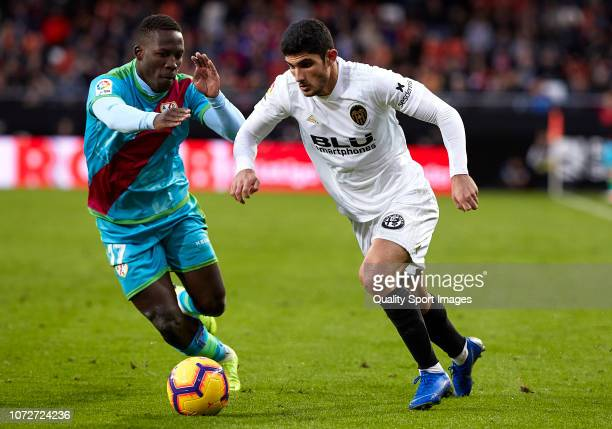 Goncalo Guedes of Valencia competes for the ball with Advincula of Rayo Vallecano during the La Liga match between Valencia CF and Rayo Vallecano de...