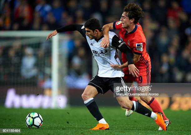 Goncalo Guedes of Valencia competes for the ball with Alvaro Odriozola of Real Sociedad during the La Liga match between Valencia CF and Real...