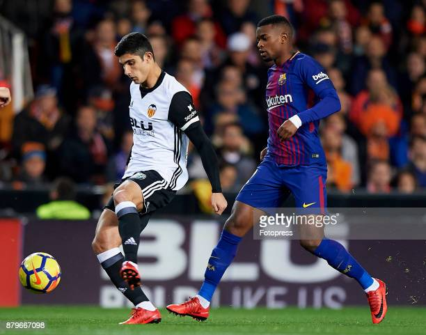 Goncalo Guedes of Valencia competes for the ball with Nelson Semedo of Barcelona during the La Liga match between Valencia and Barcelona at Estadio...