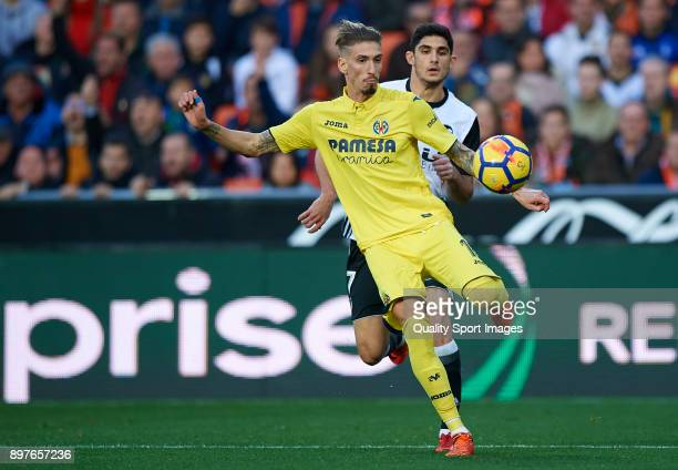 Goncalo Guedes of Valencia competes for the ball with Samuel Castillejo of Villarreal during the La Liga match between Valencia and Villarreal at...