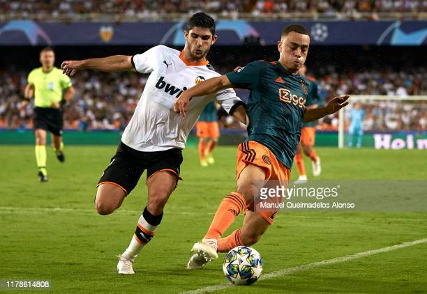 Goncalo Guedes of Valencia competes for the ball with Sergino Dest of Ajax during the UEFA Champions League group H match between Valencia CF and AFC...