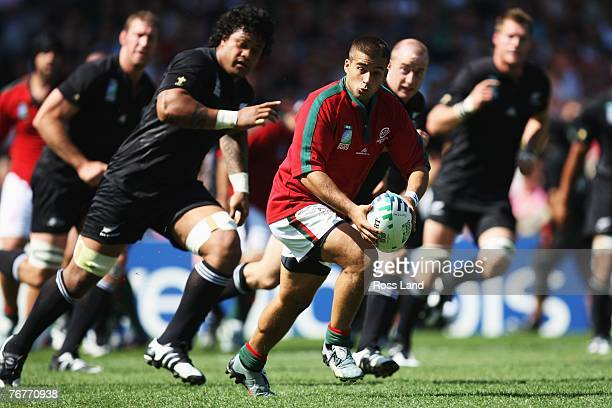 Goncalo Malheiro of Portugal breaks throught the New Zealand defence during match fourteen of the Rugby World Cup 2007 between New Zealand and...
