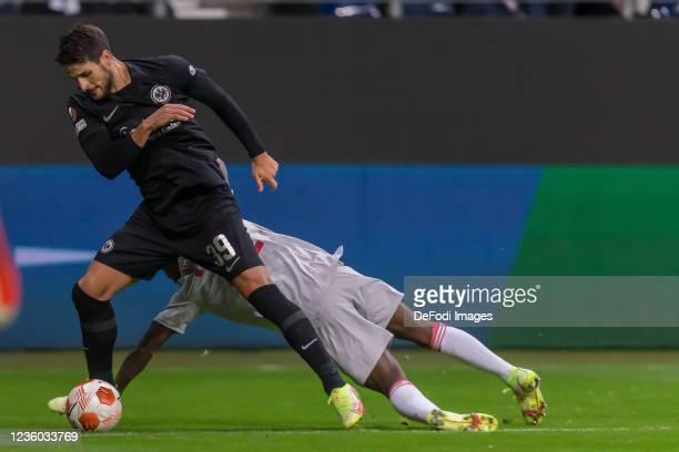 Goncalo Paciencia of Eintracht Frankfurt and Aguibou Camara battle for the ball during the UEFA Europa League group D match between Eintracht...