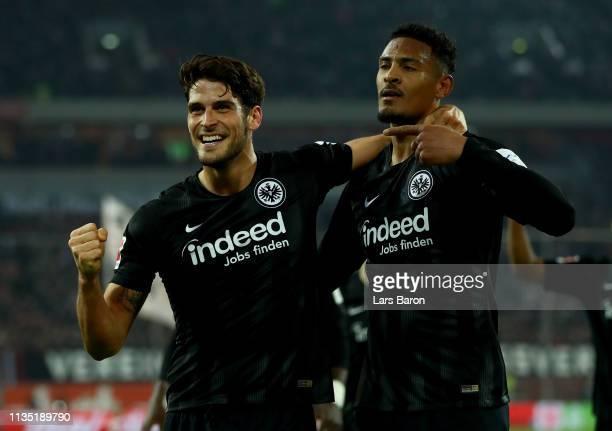 Goncalo Paciencia of Eintracht Frankfurt and Sebastien Haller of Eintracht Frankfurt celebrate during the Bundesliga match between Fortuna...
