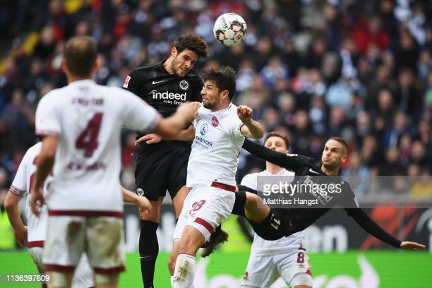 Goncalo Paciencia of Eintracht Frankfurt battles for the ball with Lukas Muhl of Nurnberg during the Bundesliga match between Eintracht Frankfurt and...