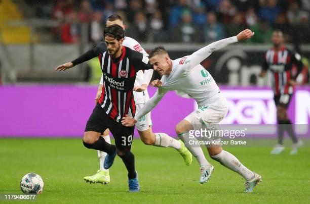Goncalo Paciencia of Eintracht Frankfurt is challenged by Marco Friedl of SV Werder Bremen during the Bundesliga match between Eintracht Frankfurt...