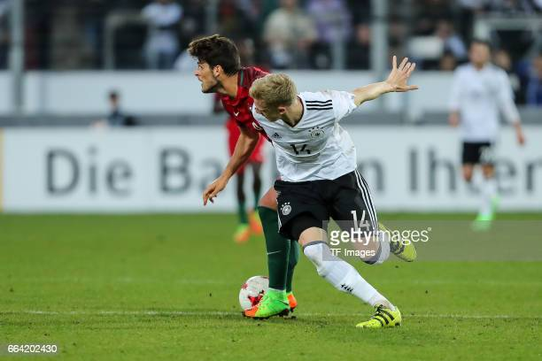 Goncalo Paciencia of Portugal und Timo Baumgartl of Germany battle for the ball during the International Friendly match between Germany U21 and...
