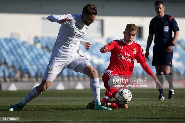 Goncalo Rodrigues of SL Benfica competes for the ball with Borja Mayoral of Real Madrid CF during the UEFA Youth League Quarter Finals match between...
