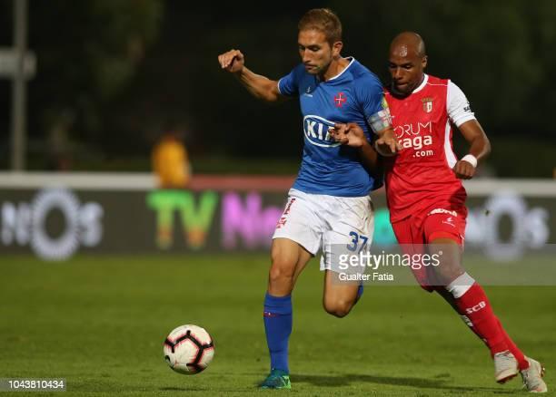 Goncalo Silva of Belenenses SAD with Wilson Eduardo of SC Braga in action during the Liga NOS match between Belenenses SAD and SC Braga at Estadio...