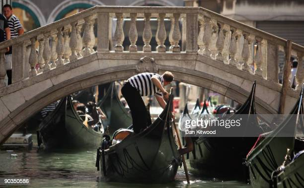 A gondelier takes tourists through the canals of Venice near San Marco's Square during the 66th Venice Film Festival on September 5 2009 in Venice...