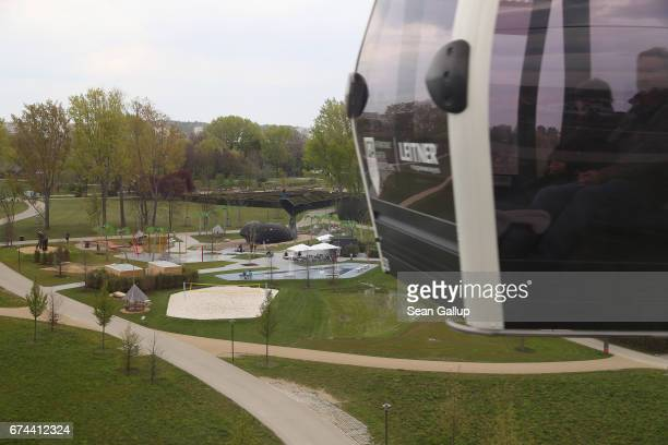 A gondola carries visitors over the IGA 2017 international garden exhibition on April 28 2017 in Berlin Germany The IGA includes horticultural...