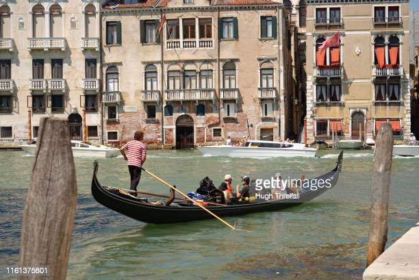 gondola in venice on the grand canal . - hugh threlfall stock pictures, royalty-free photos & images
